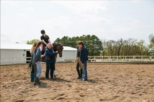 William Woods Professor teaches equestrian students about dressage.